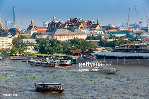 Bangkok skyline with traffic on Chao Phraya Rive