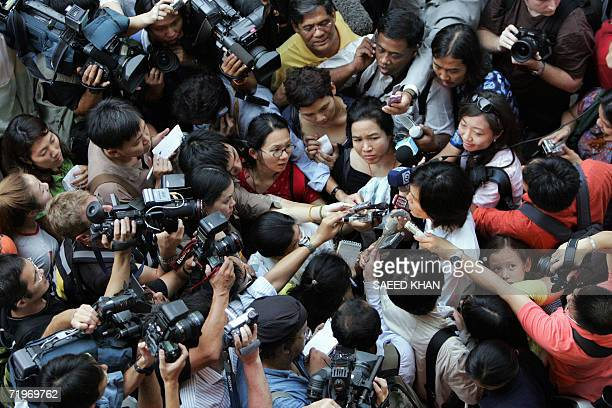 A large number of media personell attempt to get comments from a Thai protestor who appeared in front of a shopping mall against a military coup in...