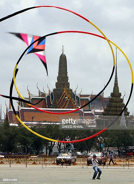 A long tail kite flies at the venue of a mass antiThai premier Thaksin Shinawatra rally in front of Grand Royal palace in Bangkok 27 February 2006...