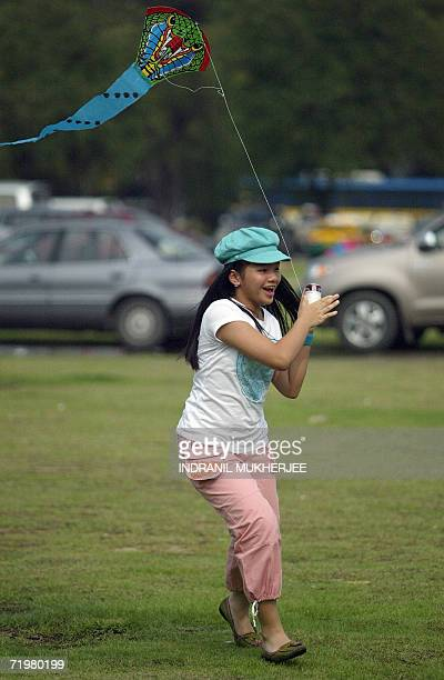 A Thai girl flies a kite at a park in central Bangkok 24 September 2006 Thailand's new military rulers rolled their tanks out of central Bangkok less...
