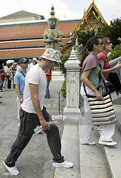 French football legend Zinedine Zidane is seen during his visit to the Grand Palace in Bangkok 20 February 2007 Zidane whose career ended with an...