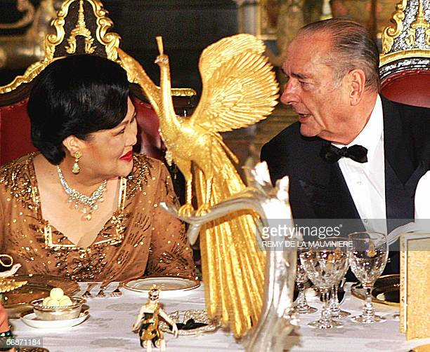 French President Jacques Chirac speaks with Queen Sirikit of Thailand at the start of a gala dinner given at the Royal Palace on the first day of his...