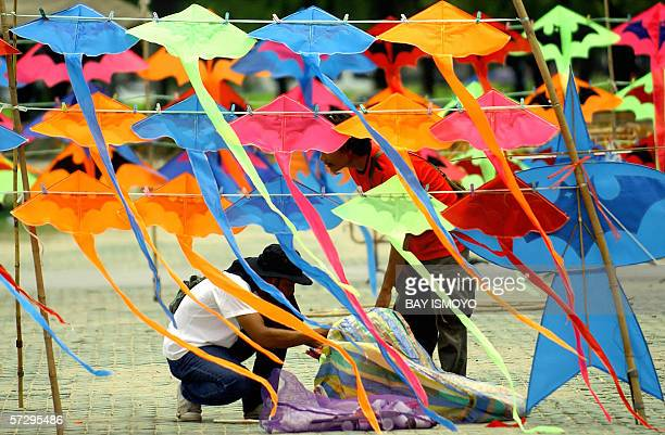 Kite vendors prepare for their business at a public park in Bangkok 08 April 2006 A private research house predicted Thailand will miss both number...