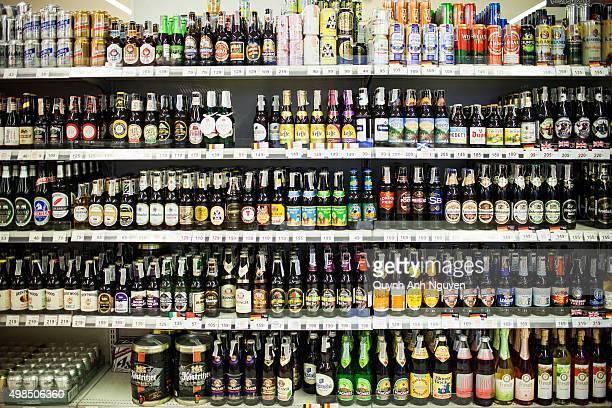 Bangkok, Thailand. Shelves in a supermarket full of imported beer bottles.