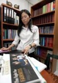 Thai lawyer Siriwan Vongkietpaisan representing late human trafficking victim Urairat Soimee checks documents at her office in Bangkok 23 August 2006...