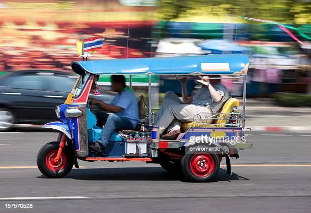 Bangkok Tuk-tuk with passengers.