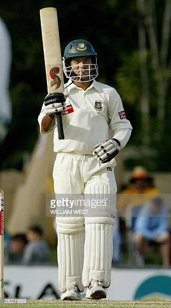 Bangladesh batsman Hannan Sarkar celebrates scoring his 50 against Australia on the third day of the second Test match in Cairns 27 July 2003...