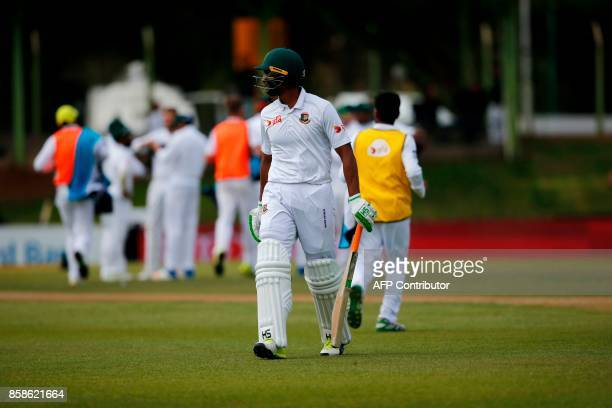 Bangladesh batsman Mahmudullah leaves the ground after South African bowler Wayne Parnell bowled him out during the second day of the second Test...