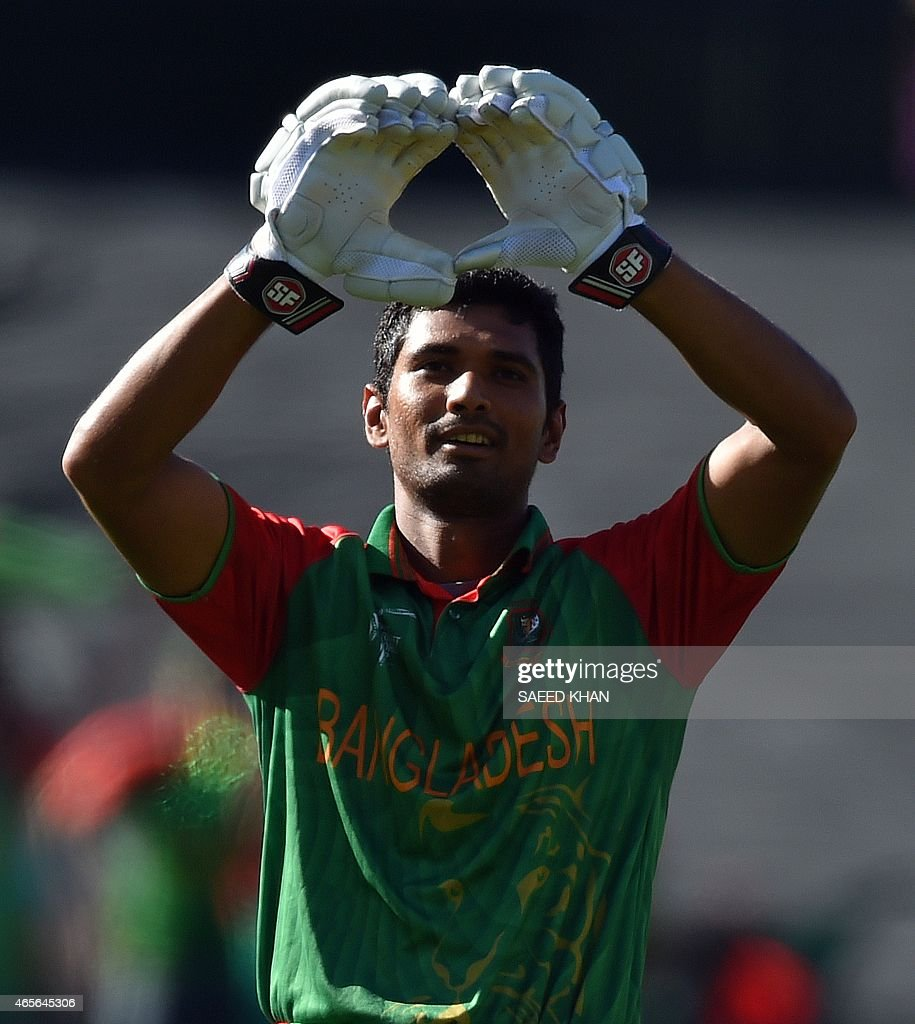 Bangladesh batsman Mahmudullah makes a heart gesture as he celebrates his century against England during the Pool A 2015 Cricket World Cup match between Bangladesh and England at the Adelaide Oval on March 9, 2015. AFP PHOTO / Saeed KHAN USE--