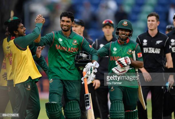 Bangladesh batsman Mohammad Mahmudullah celebrates with team mates after hitting the winning runs during the ICC Champions Trophy match between New...