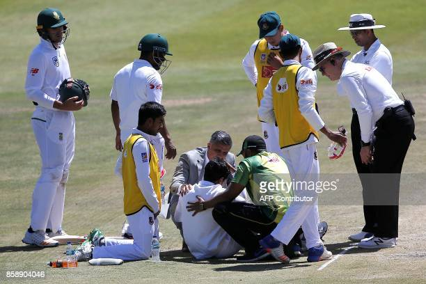 Bangladesh batsman Mushfiqur Rahim is attended by medics and team members after he was hit on the head by a ball delivered by South Africa bowler...