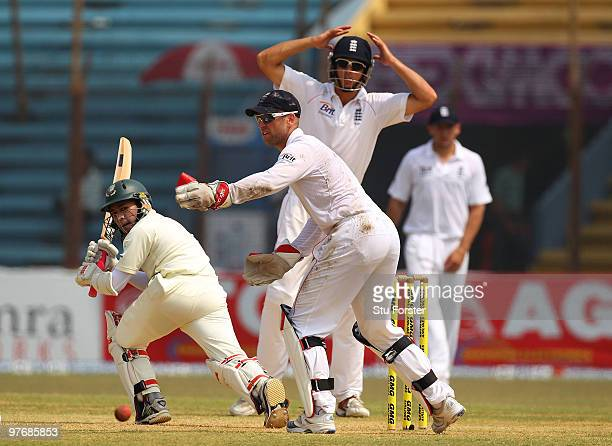 Bangladesh batsman Mushfiqur Rahim picks up some runs watched by Matt Prior and Alastair Cook during day three of the 1st Test match between...