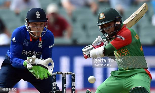 Bangladesh batsman Mushfiqur Rahim plays a shot as England's wicket Jos Buttler looks on during the Pool A 2015 Cricket World Cup match between...