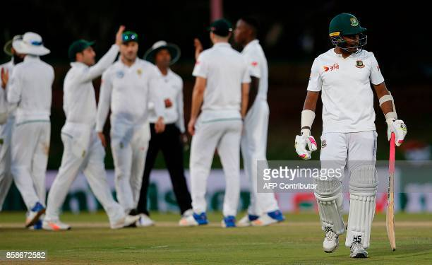 Bangladesh batsman Rubel Hossain walks back to the pavilion after his dismissal by South Africa's Kagiso Rabada during the second day of the second...