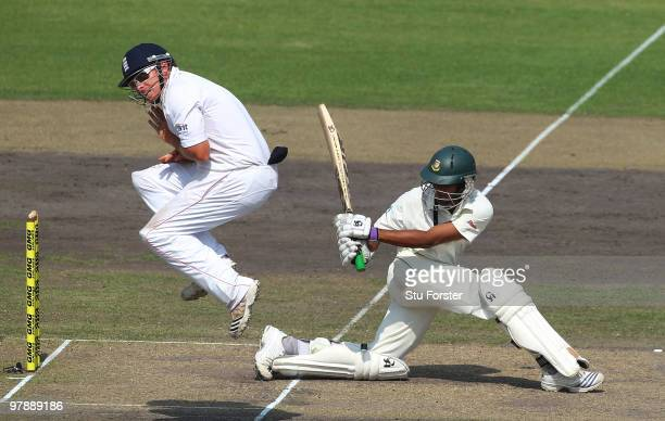 Bangladesh batsman Shakib Al Hasan hits out as England fielder Ian Bell jumps out of the way during day one of the 2nd Test match between Bangladesh...
