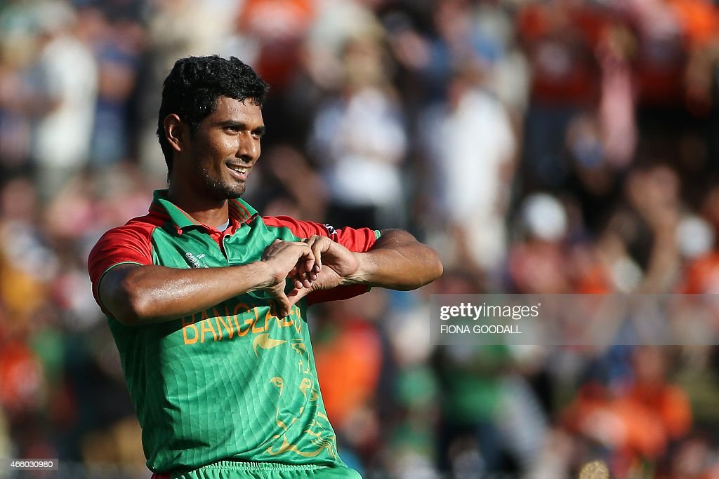 Bangladesh batsmen <a gi-track='captionPersonalityLinkClicked' href=/galleries/search?phrase=Mohammad+Mahmudullah&family=editorial&specificpeople=4506203 ng-click='$event.stopPropagation()'>Mohammad Mahmudullah</a> celebrates his century in the Pool A 2015 Cricket World Cup match between New Zealand and Bangladesh at Seddon Park, Hamilton on March 13, 2015. AFP PHOTO / Fiona Goodall