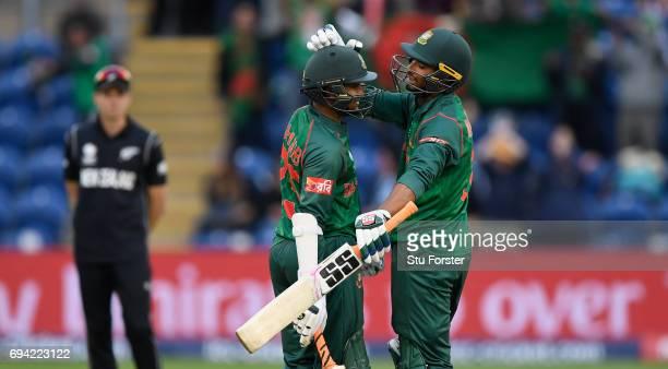 Bangladesh batsmen Shakib Al Hasan and Mohammad Mahmudullah celebrate after Hasan had reached his century during their partnership during the ICC...