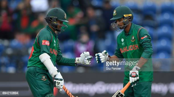 Bangladesh batsmen Shakib Al Hasan and Mohammad Mahmudullah punch gloves during their partnership during the ICC Champions Trophy match between New...