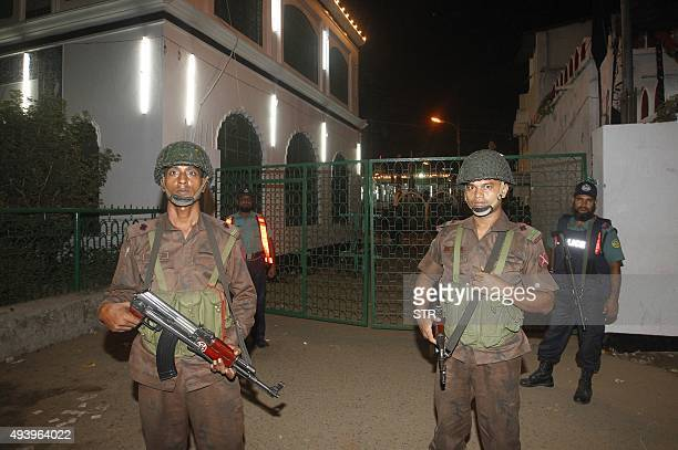 Bangladesh Border Guard members stand guard after a small a small bomb exploded outside Bangladesh capital's main Shia religious site in Dhaka on...