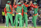 Bangladesh bowler Mashrafe Mortaza celebrates the wicket of unseen Pakistan batsman Umer Akmal with teammates during a oneday international warmup...