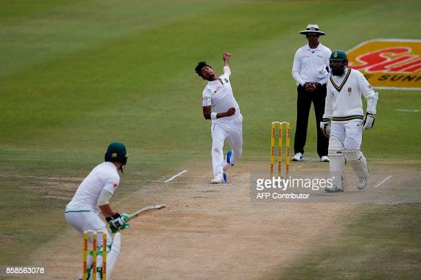 Bangladesh bowler Mustafizur Rahman delivers to South Africa batsman Faf du Plessis during the second day of the second Test Match between South...