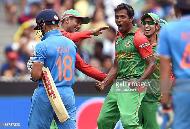 Bangladesh bowler Rubel Hossain gives India's batsman Virat Kohli a sendoff after dismissing him cheaply during their 2015 Cricket World Cup...