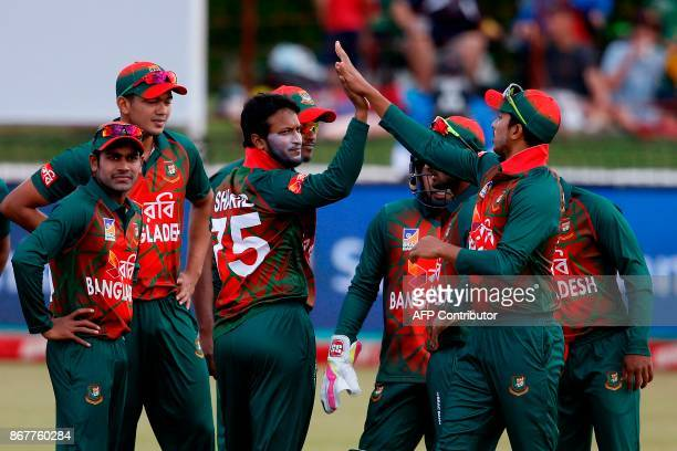 Bangladesh bowler Shakib Al Hasan celebrates the dismissal of South African batsman Mangaliso Mosehle during the second T20 Match between South...