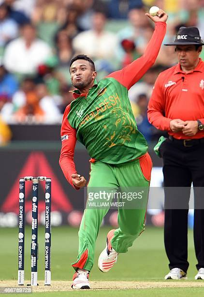 Bangladesh bowler Shakib Al Hasan sends down a delivery to the Indian batsman during their 2015 Cricket World Cup quarterfinal match in Melbourne on...