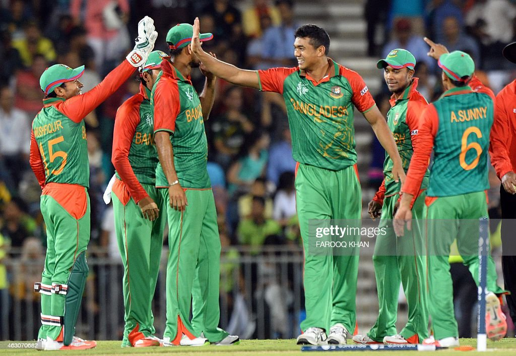 Bangladesh bowler Taskin Ahmed celebrates the wicket of unseen Pakistan batsman MisbahulHaq with wicketkeeper Mushfiqur Rahim during a oneday...