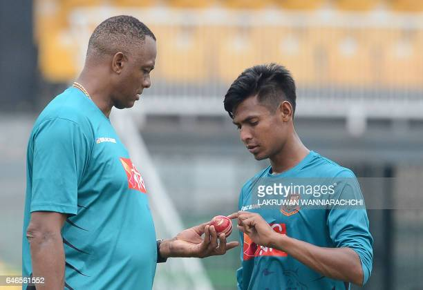 Bangladesh bowling coach Courtney Walsh gives instructions to cricketer Mustafizur Rahman during a practice session at the R Premadasa Stadium in...