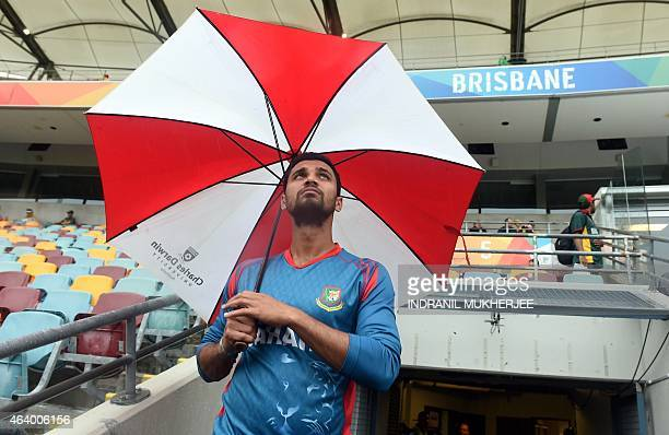 Bangladesh captain Mashrafe Mortaza looks skywards from the players' entrance to the ground as rain from Cyclone Marcia delays the start of the 2015...