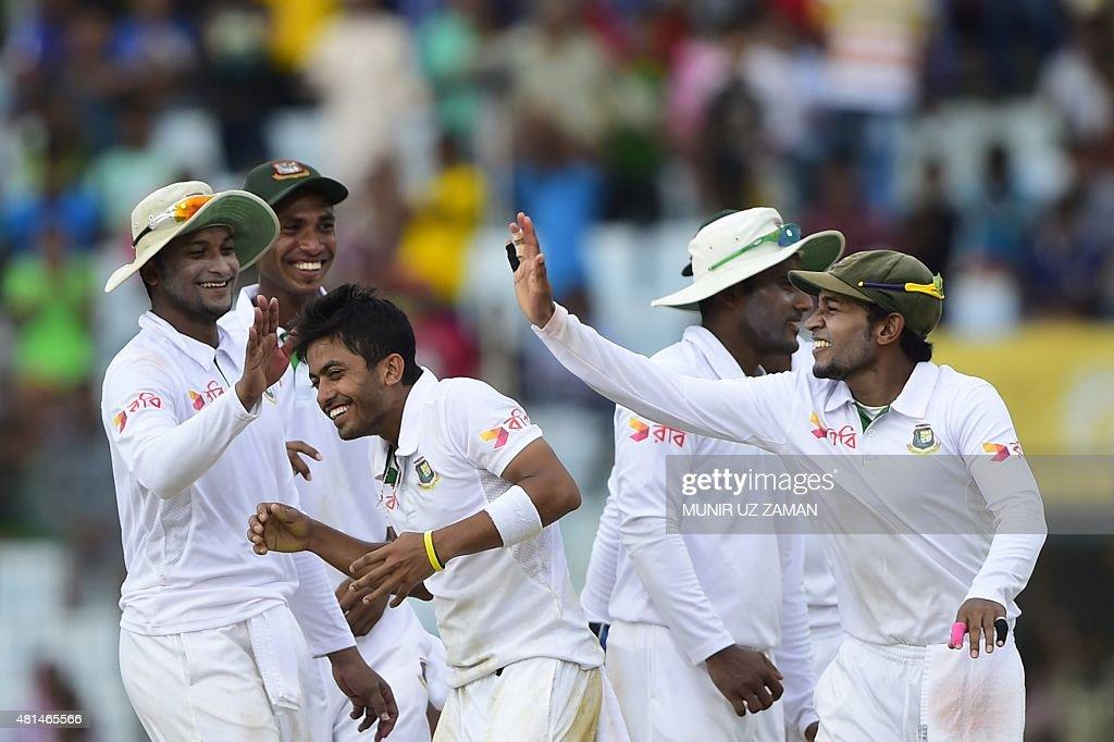 Bangladesh captain Mushfiqur Rahim and cricketer Shakib Al Hasan congratulate teammate Jubair Hossain for the dismissal of South African cricketer...