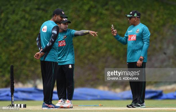 Bangladesh captain Mushfiqur Rahim and teammate Tamim Iqbal and coach Chandika Hathurusingha inspect the pitch during a practice session at the P...