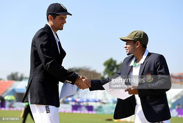 Bangladesh captain Mushfiqur Rahim shakes hands with England captain Alastair Cook ahead of the first Test match between Bangladesh and England at...