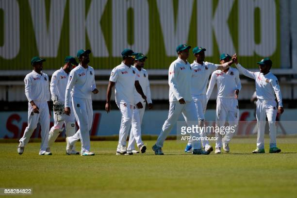 Bangladesh Captain Mustafizur Rahman is celebrated after catching out South African batsman Dean Elgar during the first day of the second cricket...