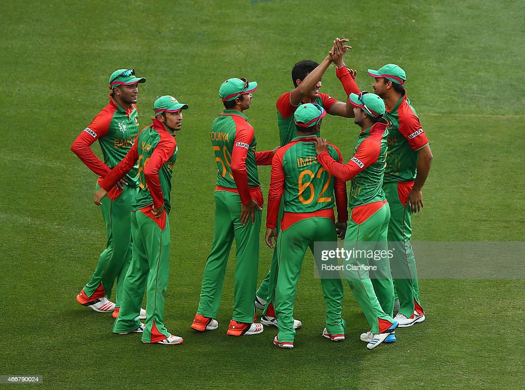Bangladesh celebrate the wicket of Ajinkya Rahane of India during the 2015 ICC Cricket World Cup match between India and Bangldesh at Melbourne...