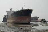 ship breaking yard where migrant laborers dismantle ships almost by hand Scrap ships mostly oil tankers and vessels those used to carry toxic items...