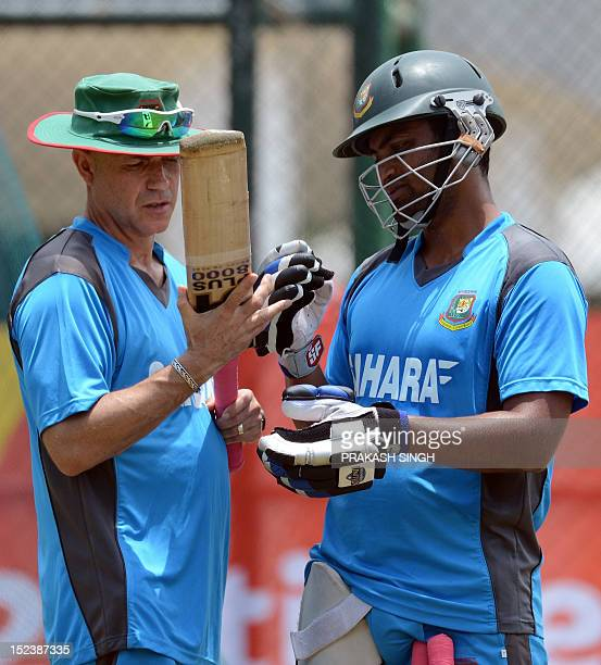 Bangladesh coach Richard Pybus talks with Tamim Iqbal in the nets during a training session at The Pallekele International Cricket Stadium in...
