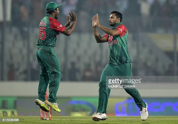 Bangladesh cricket captain Mashrafe Bin Mortaza celebrates with teammate Imrul Kayes after the dismissal of unseen Indian batsman Virat Kohli during...