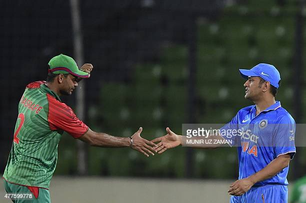 Bangladesh cricket captain Mashrafe Bin Mortaza shakes hand with Indian cricket captain Mahendra Singh Dhoni after winning the first one day...