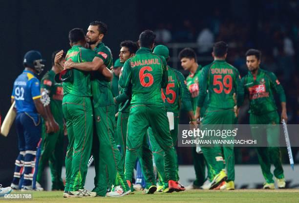 Bangladesh cricket captain Mashrafe Mortaza and teammates celebrate their victory in the second Twenty20 international cricket match between Sri...