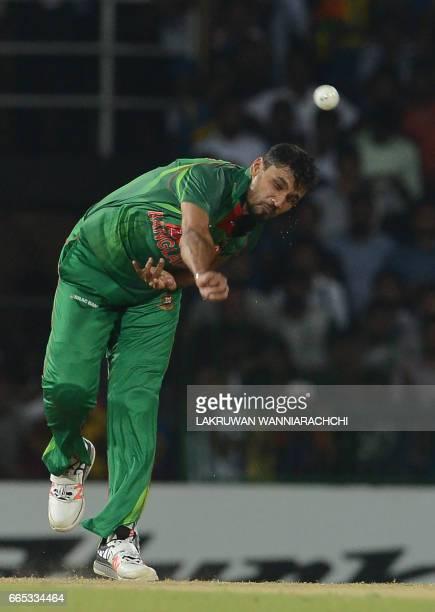 Bangladesh cricket captain Mashrafe Mortaza bowls during the second T20 international cricket match between Sri Lanka and Bangladesh at the R...