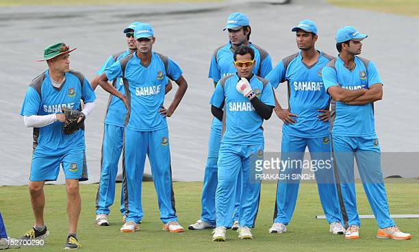 Bangladesh cricket captain Mushfiqur Rahim and teammates listen to coach Richard Pybus during a training session on the eve of the ICC Twenty20...