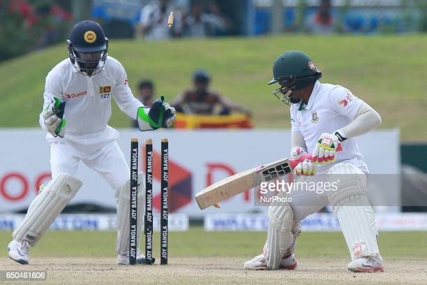Bangladesh cricket captain Mushfiqur Rahim looks back towards his wicket after being dismissed by unseen Sri Lankan spinner Rangan Herath as...