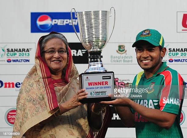 Bangladesh cricket captain Mushfiqur Rahim receives the OneDay International trophy from the Bangladesh Prime Minister Shiekh Hasina Wajed after New...