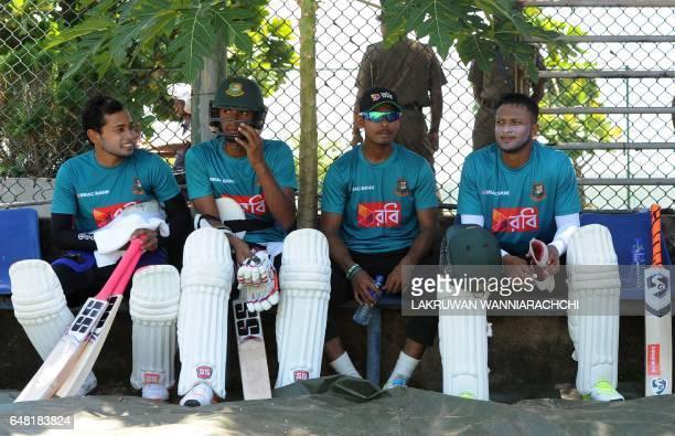 Bangladesh cricket captain Mushfiqur Rahim sits with teammates Mustafizur Rahman Mustafizur Rahman and Shakib Al Hasan during a practice session at...