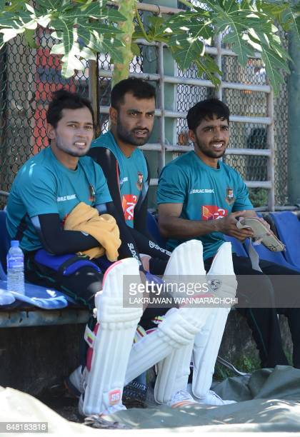 Bangladesh cricket captain Mushfiqur Rahim sits with teammates Tamim Iqbal and Mominul Haque during a practice session at The Galle International...
