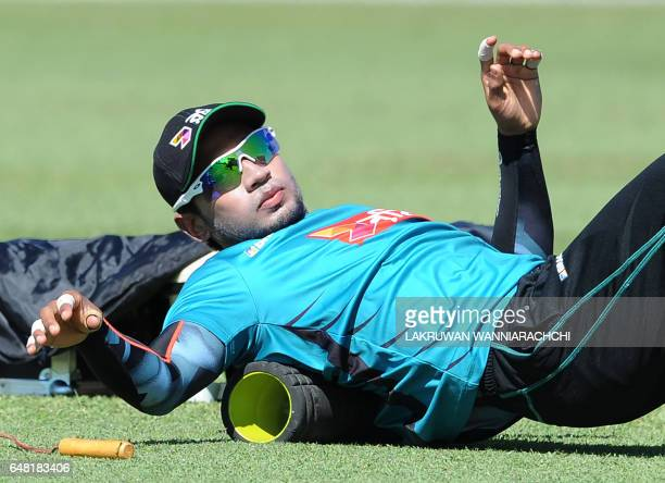 Bangladesh cricket captain Mushfiqur Rahim stretches during a practice session at The Galle International Cricket Stadium in Galle on March 5 ahead...