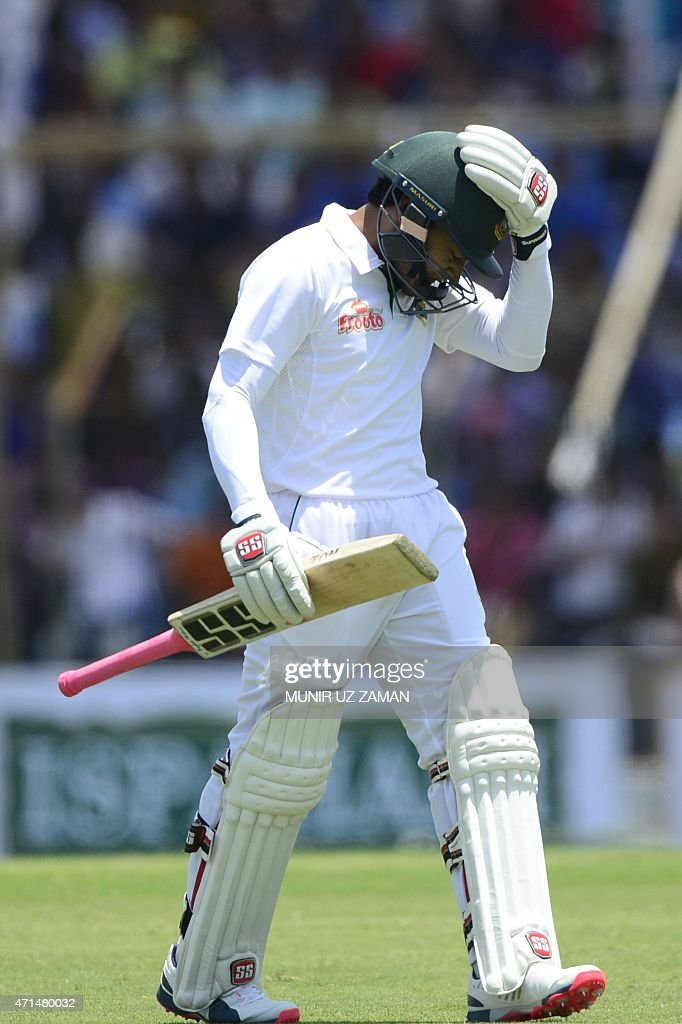 Bangladesh cricket captain Mushfiqur Rahim walks off the the field after being dismissed by Pakistan bowler Yasir Shah during the second day of the...