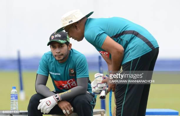 Bangladesh cricket coach Chandika Hathurusingha gives instructions to captain Mushfiqur Rahim during a practice session at the R Premadasa Stadium in...